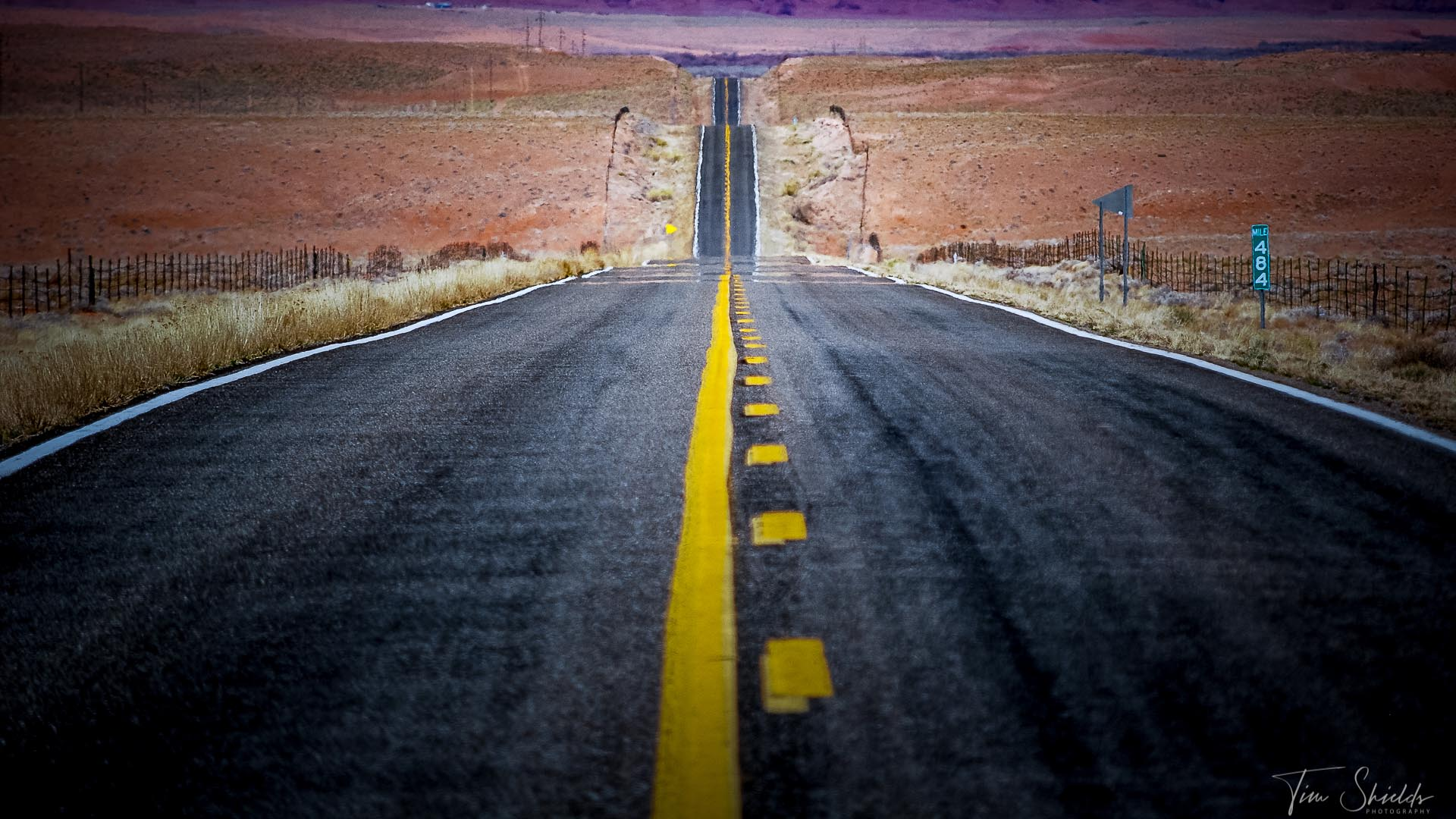 A photo of a long, straight road in Death Valley