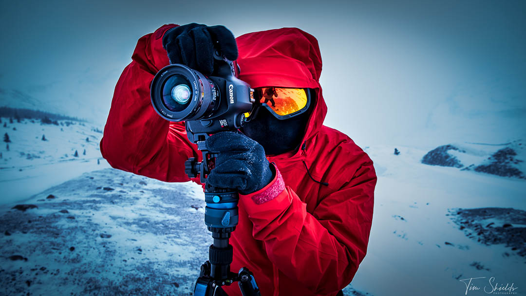 A photographer taking a photo in a frigid ice field